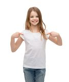 Smiling little girl in blank white t-shirt stock photos