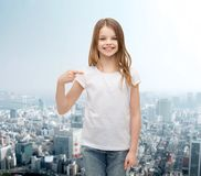 Smiling little girl in blank white t-shirt Royalty Free Stock Images
