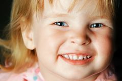 Smiling little girl with blue eyes Royalty Free Stock Image