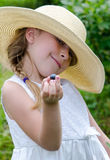 Smiling Little girl at a blueberry farm Royalty Free Stock Photo