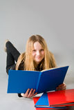 Smiling little girl with a book Royalty Free Stock Images