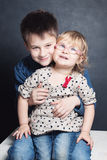 Smiling Little Girl and Boy Sibling Stock Images