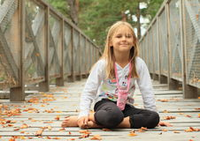 Smiling little girl on bridge Stock Photo