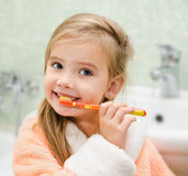 Smiling little girl brushing teeth Royalty Free Stock Photo
