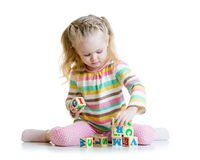 Smiling little girl is building a toy block Stock Photos