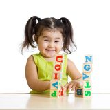 Smiling little girl is building a toy block Royalty Free Stock Images