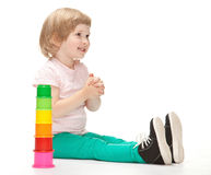 Smiling little girl building toy pyramid Stock Photography