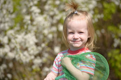 Smiling little girl with a butterfly net Stock Image