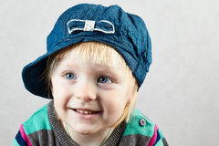 Smiling little girl   with a cap on her head Royalty Free Stock Photo