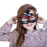 Smiling little girl in the carnival mask Royalty Free Stock Photography
