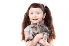 Smiling little girl with a cat. Smiling little girl a studio portrait of a smiling little girl holding a kitten in her hands isolated on white background Royalty Free Stock Photo