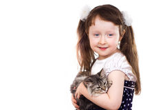 Smiling little girl with a cat. Smiling little girl a studio portrait of a smiling little girl holding a kitten in her hands isolated on white background Royalty Free Stock Images