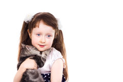 Smiling little girl with a cat. Smiling little girl a studio portrait of a smiling little girl holding a kitten in her hands isolated on white background Royalty Free Stock Image