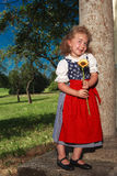 Smiling little girl with charming Bavarian Stock Photography