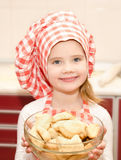 Smiling little girl in chef hat holding bowl Royalty Free Stock Photo
