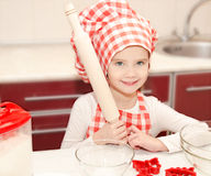Smiling little girl with chef hat Stock Image