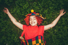 Smiling little girl in clown wig Stock Images