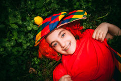 Smiling little girl in clown wig Stock Image