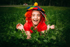 Smiling little girl in clown wig Royalty Free Stock Photo