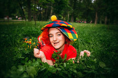 Smiling little girl in clown wig Stock Photo