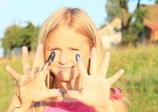 Smiling little girl with colored fingers Royalty Free Stock Photo