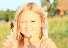 Smiling little girl with colored fingers Stock Photos