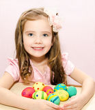 Smiling little girl with colorful easter eggs Stock Photography