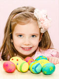 Smiling little girl with colorful easter eggs Stock Photos