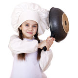 Smiling little girl in cook hat with frying pan Stock Images