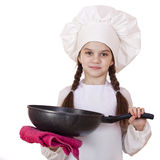 Smiling little girl in cook hat with frying pan Stock Photography