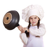 Smiling little girl in cook hat with frying pan Stock Photos