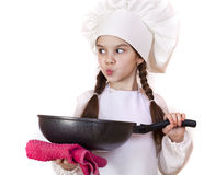 Smiling little girl in cook hat with frying pan Stock Image