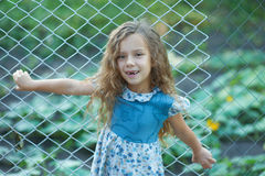 Smiling little girl with curly hair Stock Photos