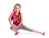 Smiling little girl doing exercise Stock Photos