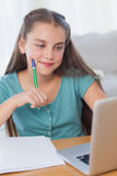 Smiling little girl doing her homework Stock Images