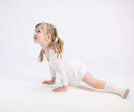 Smiling little girl doing the splits Stock Images
