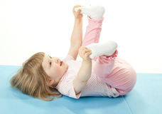 Smiling little girl doing sport exercises Royalty Free Stock Photography