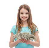 Smiling little girl with dollar cash money Royalty Free Stock Image