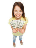 Smiling little girl with dollar cash money Stock Images