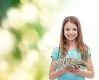 Smiling little girl with dollar cash money Stock Image