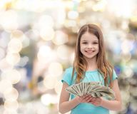 Smiling little girl with dollar cash money Royalty Free Stock Photos