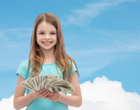 Smiling little girl with dollar cash money. Money, finances and people concept - smiling little girl with dollar cash money stock image
