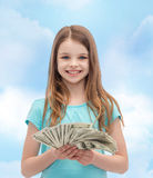 Smiling little girl with dollar cash money Royalty Free Stock Images