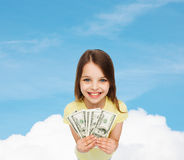 Smiling little girl with dollar cash money. Money, finances and people concept - smiling little girl with dollar cash money royalty free stock image