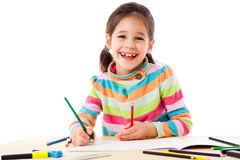 Smiling little girl draw with crayons Stock Photography