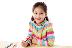 Smiling little girl draw with crayons Stock Images