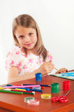 Smiling little girl drawing picture, paints, hobby Royalty Free Stock Photography