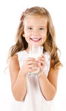 Smiling little girl drinking milk isolated on a white Royalty Free Stock Photos