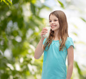 Smiling little girl drinking milk out of glass Royalty Free Stock Photo