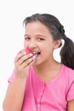 Smiling little girl eating apple Stock Image